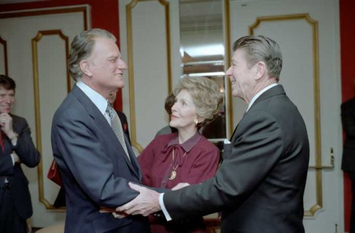 Billy Graham being greeted by Nancy and Ronald Reagan in 1981. Uploaded by reagan.utexas.edu.