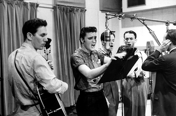 Elvis recording with the Jordanaires, 1956. Uploaded by timeinc.net.