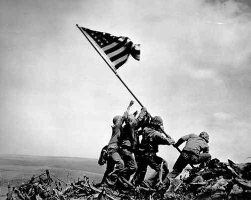 Marines raise flag at Iwo Jima. Uploaded by phoenixcis.com.