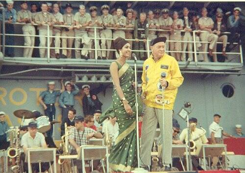 Bob Hope and the reigning Miss World entertain aboard the USS Bennington in 1966. Uploaded by uss-bennington.org.