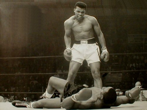 In his first title fight, Ali upset the heavily favored Sonny Liston. Uploaded by img65.imageshack.us.